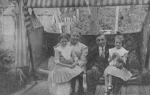 This is a picture of Libby with Nanny's older sisters and some guy I can't identify.  She looks like a perfect grandmother to me.  Source: copy of a family photo.